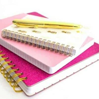 Planner stack with gold pen